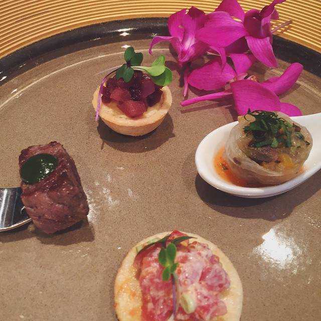 Ahi tartare, filet of beef, grilled vegetable summer roll with…